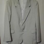 Фирменный пиджак -красивый и стильный ,размер 54.состояние нового