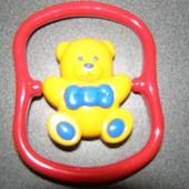 Игрушка погремушка вращающийся мишка TOLO