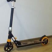 самокат Roces scooter черно-оранжевый